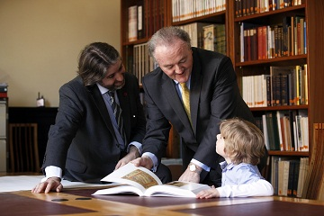 Caption : Stuart McLaughlin, Chief Executive, Business to Arts, with Brendan Murphy, Chief Executive, Allianz look at books in the Chester Beatty Library with Harry McLaughlin (7)