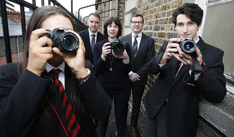 Garry Ferguson, Managing Partner, Walkers; Kate Nolan, Walkers Photographer in Residence & Andrew Hetherington, Chief Executive, Business to Arts with transition year students Amina Ward and Samuel Rodrigues de Amorim Tavares of CBS Westland Row. Picture Conor McCabe Photography.