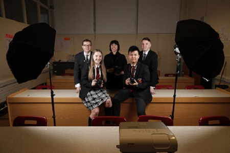 Garry Ferguson, Managing Partner, Walkers; Kate Nolan, Walkers Photographer in Residence & Andrew Hetherington, Chief Executive, Business to Arts with transition year students Casey Swaine & Yung Kien Chong of CBS Westland Row.