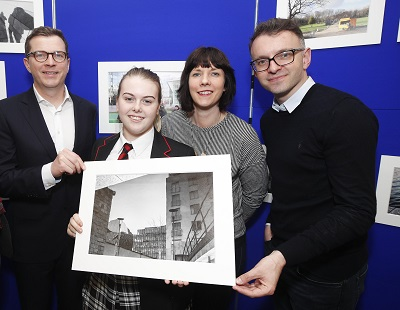 Garry Ferguson, Managing Partner, Walkers, Walkers photographer in Residence Kate Nolan and Andrew Hetherington, Chief Executive, Business to Arts with transition year student Hollie Hanevy of CBS Westland Row at the launch of photographic exhibition titled 'Docklands Story Walks'. The exhibition is part of CBS Westland Row's engagement with Kate Nolan, Walkers Photographer in Residence under the Docklands Arts Fund. The students' project work was exhibited at the Walkers offices alongside Walkers staff photography, showcasing the development of their photographic skills together. See businesstoarts.ie for further details. Picture Conor McCabe Photography. MEDIA CONTACT : helen@businesstoarts.ie