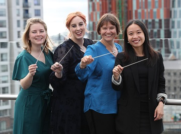Conductor Alice Farnham with participants of the NCH Fmeacl Doncuctor Programme 2018/2019 in partnership with Grant Thornton
