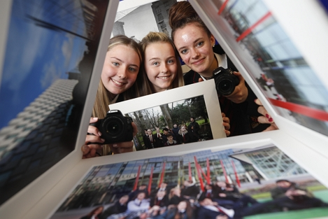 CBS Westland Row TY students Casey Swaine, Caitlin Tucker and Csenge Horvath at the photographic showcase of 'Docklands Story Walks' exhibition, in Walkers Ireland, 2018. Picture: Conor McCabe Photography.
