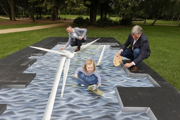 Merrion Square, Dublin, Tuesday 13th July: Pat O'Doherty, Chief Executive ESB with his granddaughter Eve (2) and Andrew Hetherington, Chief Executive, Business to Arts, painting a sustainable future with a 3D artwork by artist Mark Cronin at the announcement of ESB's Brighter Future Arts Fund. Photo: Conor McCabe